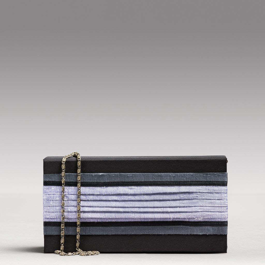 Silk charmeuse evening bag with hand-pleated, richly-textured front panel detail.