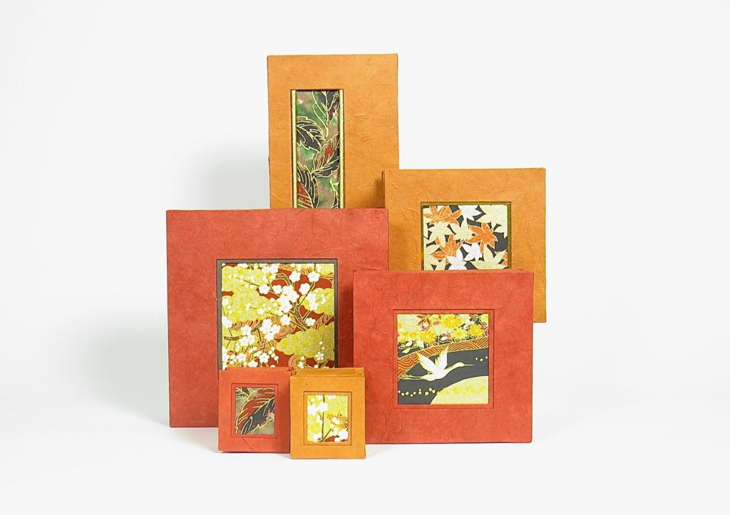 Selection of boxes in shades of orange and red