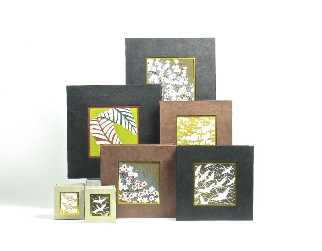 Selection of boxes in browns and black